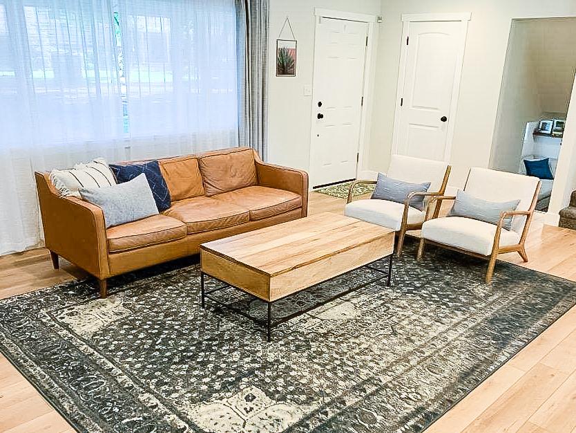 Beautiful living room with Calypso Oak LVP flooring   PFC